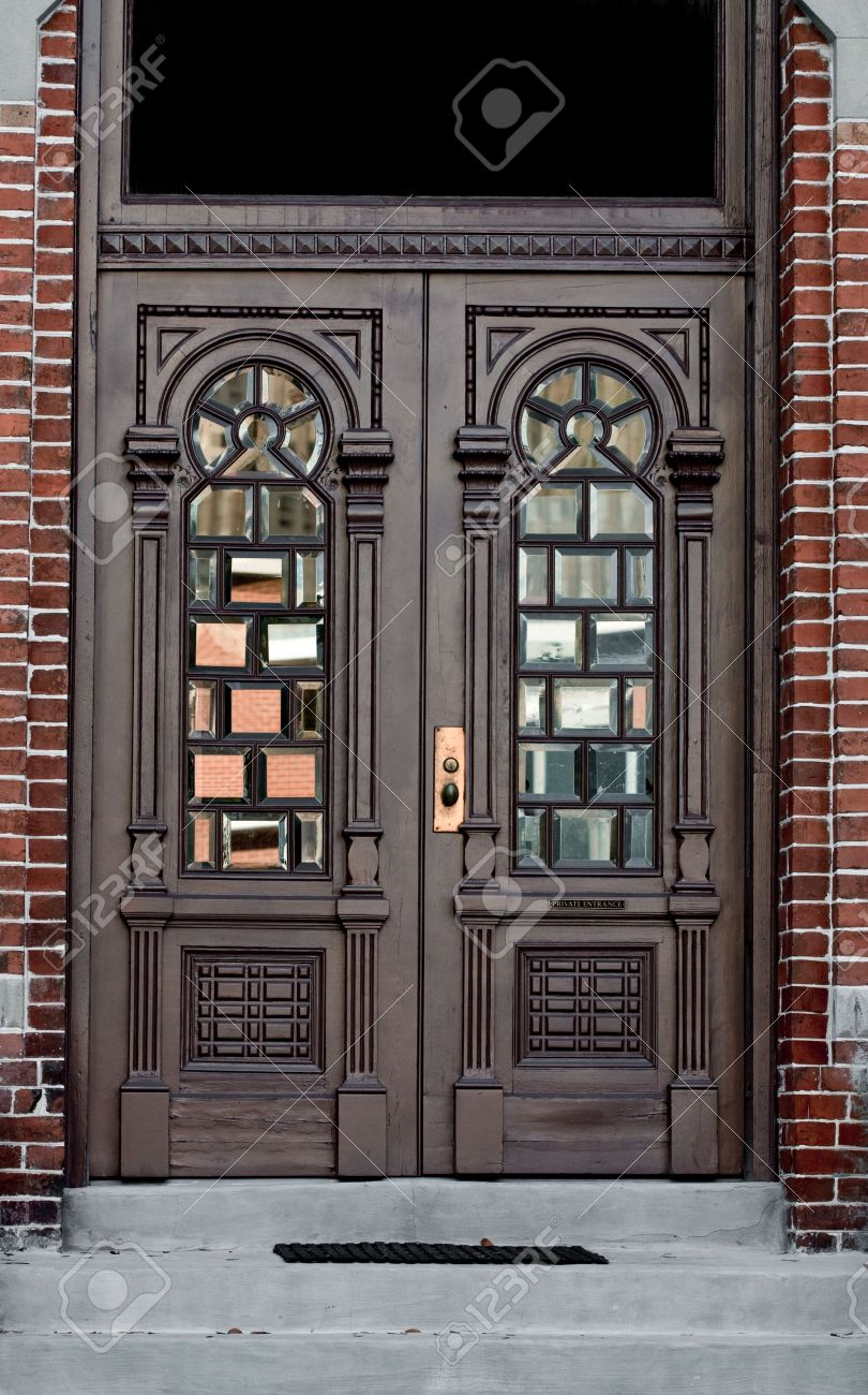 Ornate antique doors with windows in brick wall Stock Photo - 5796916 - Ornate Antique Doors With Windows In Brick Wall Stock Photo, Picture