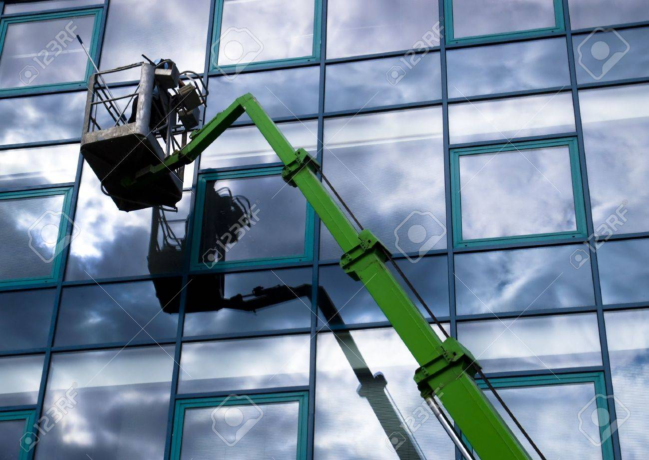 Window cleaner working on a glass facade in a gondola Stock Photo - 7445256