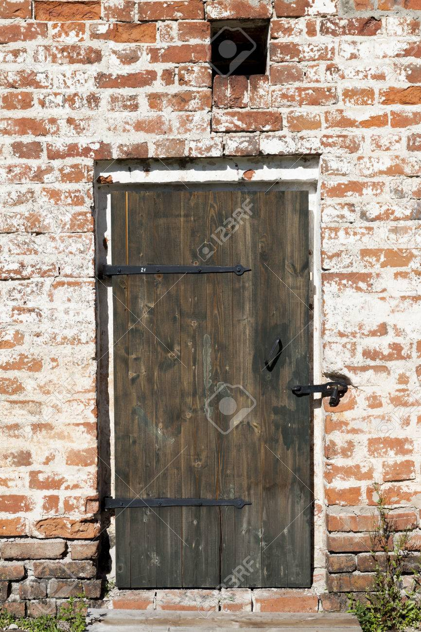 Old door in the stone walls of the village houses. Excellent background - 61544530