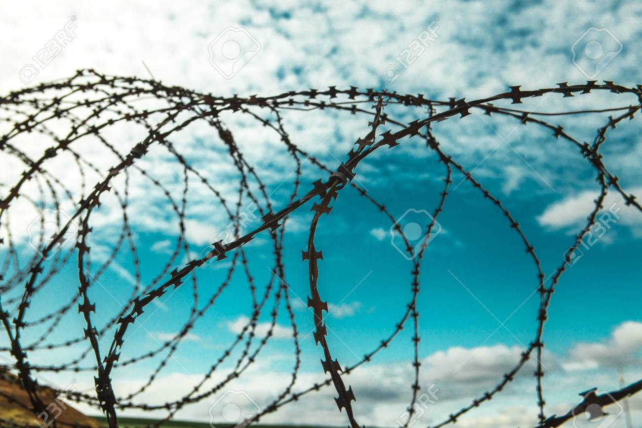 Barbed Wire. Barbed Wire On Blue Sky Background With White Clouds ...