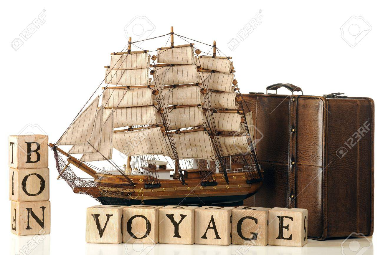 A brown leather suitcase and model tall ship by rustic alphabet