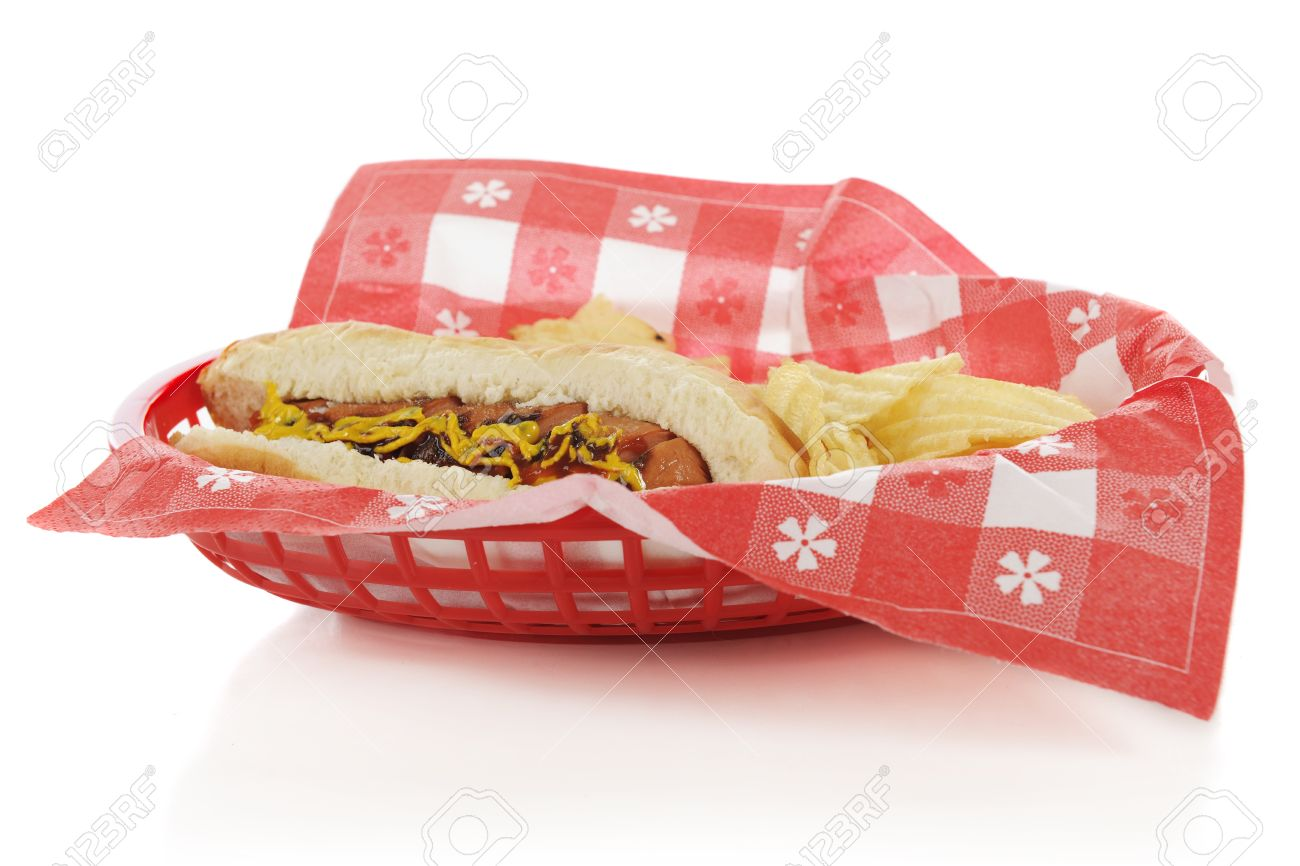 Closeup view of a plastic basket containing a hot dog on a bun with potatoe chips   Focus on hot dog   On a white background Stock Photo - 13904060