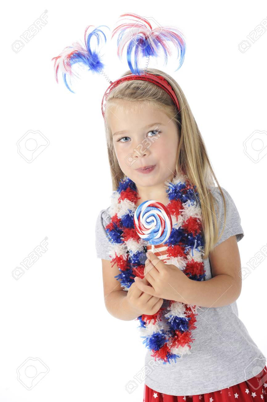 An adorable preschooler with U S  colored accessories and enjoying a red, white and blue lollipop   On a white background Stock Photo - 13963665