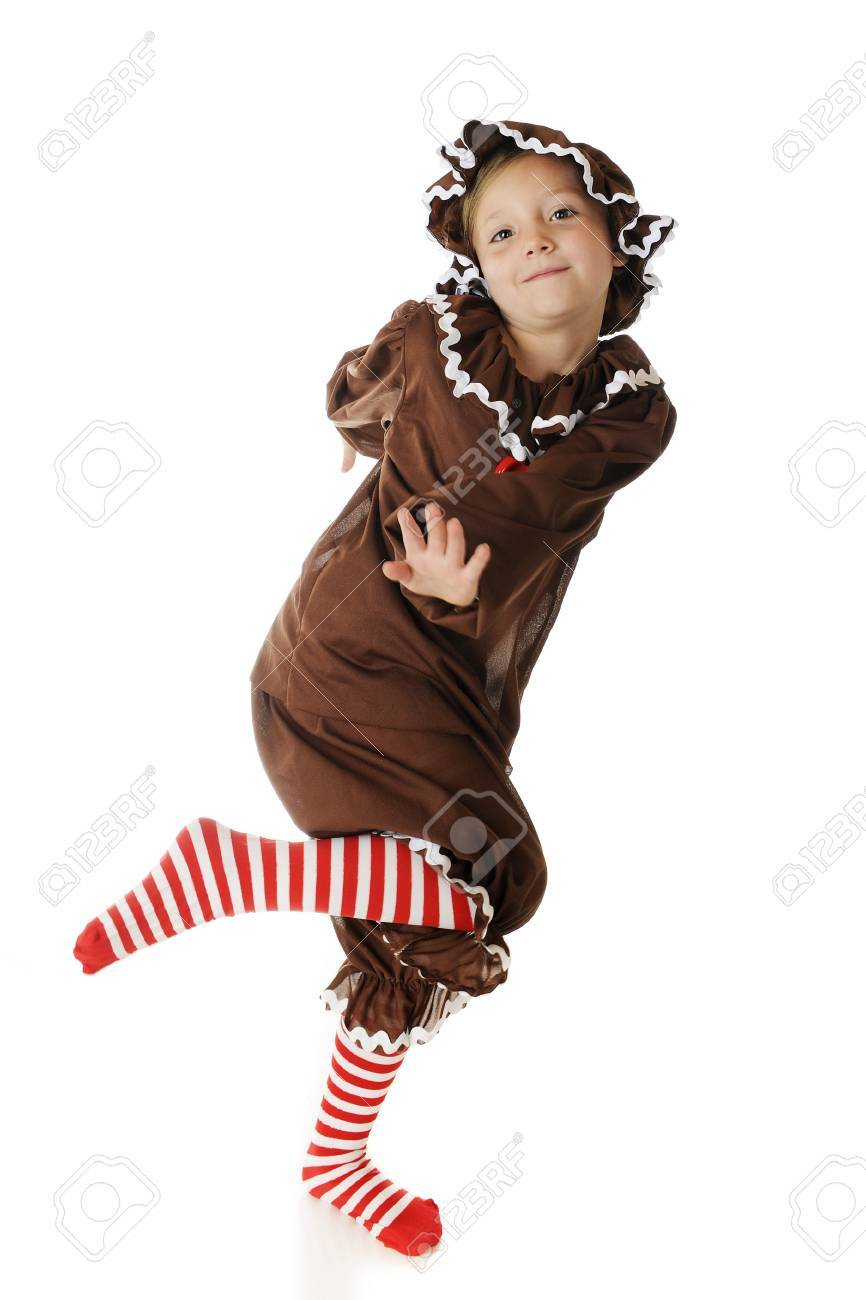 An adorable elementary gingerbread girl, fully engaged in a happy dance.  On a white background. Stock Photo - 15289320