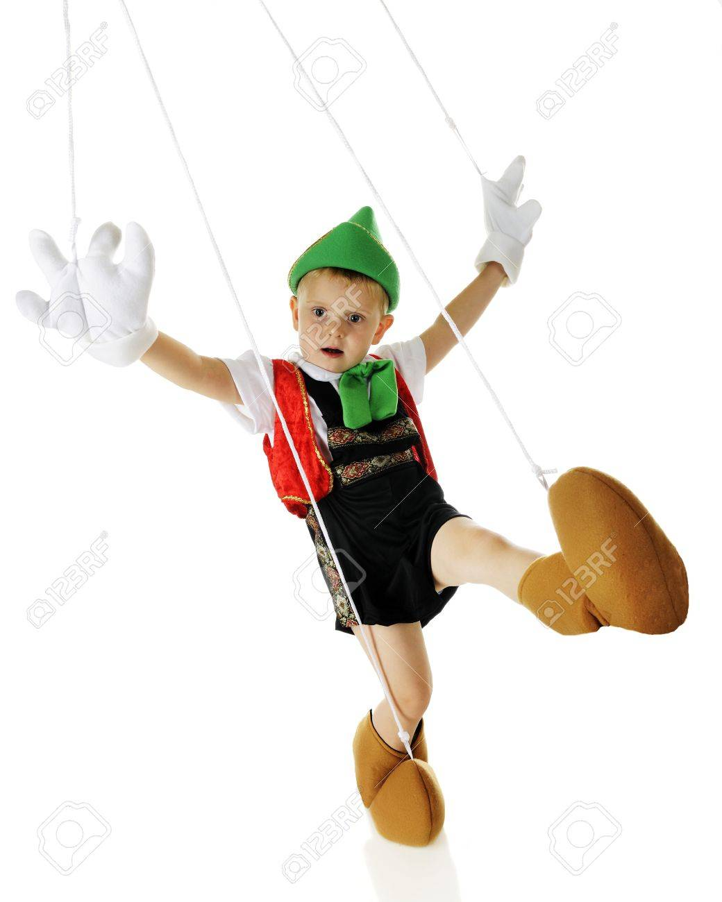 an adorable live preschool pinocchio marionette dancing strings