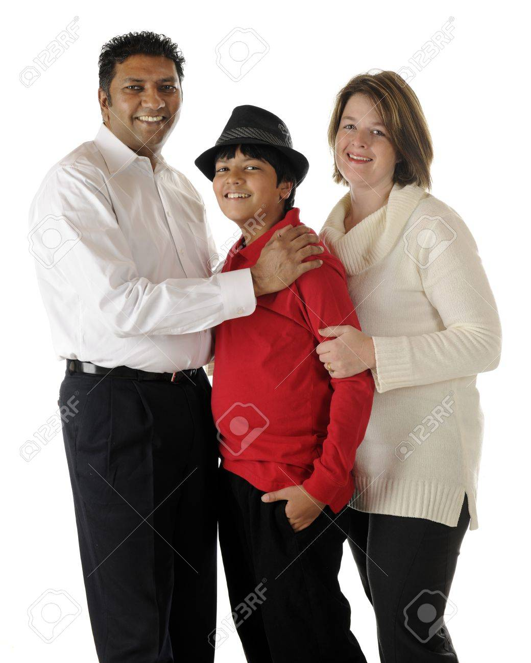 Standing portrait of a happy biracial family of three -- an Asian Indian dad, caucasian mom and their preteen son   On a white background Stock Photo - 17165328