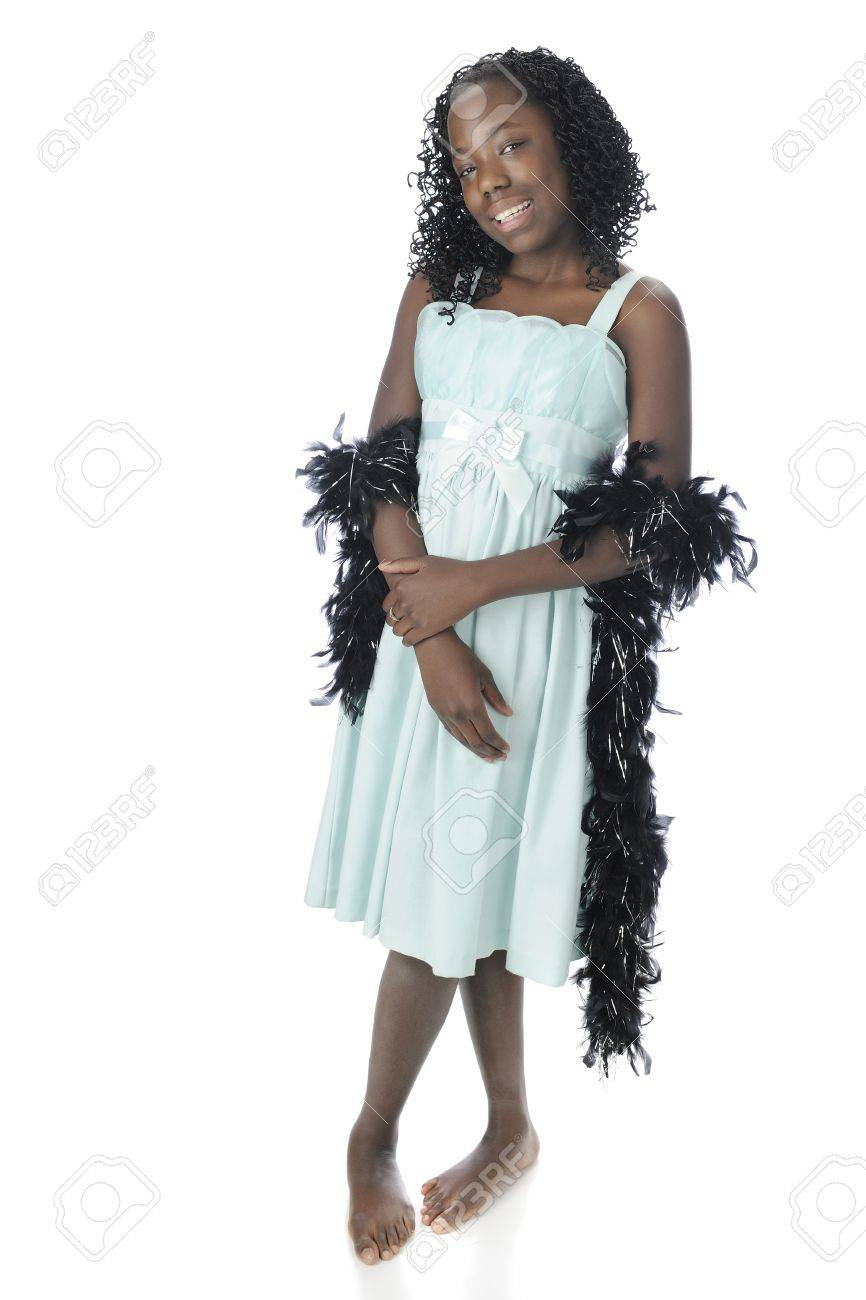 black preteen A standing portrait of a beautiful black preteen dressed up , though  barefoot, with a