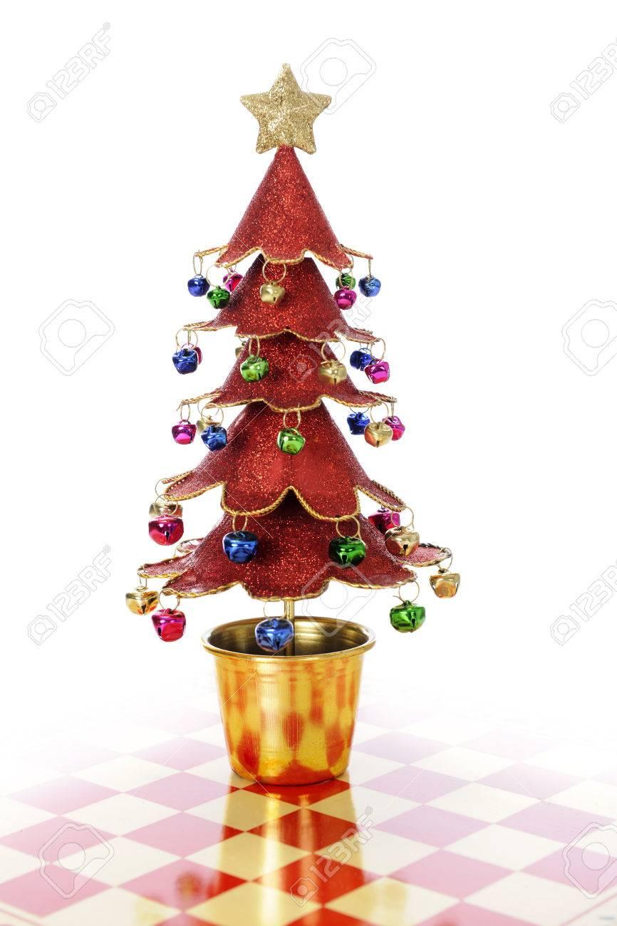 A Sparkly Redl Christmas Tree Setting On A Red And Cream Colored Stock Photo Picture And Royalty Free Image Image 22985825