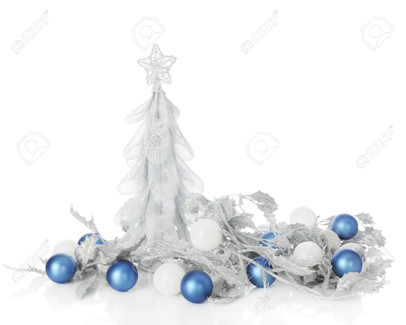 a simulated silver christmas tree surrounded by sparkly silver leaves blue and frosty white ornaments - Frosty Blue Christmas Decorations