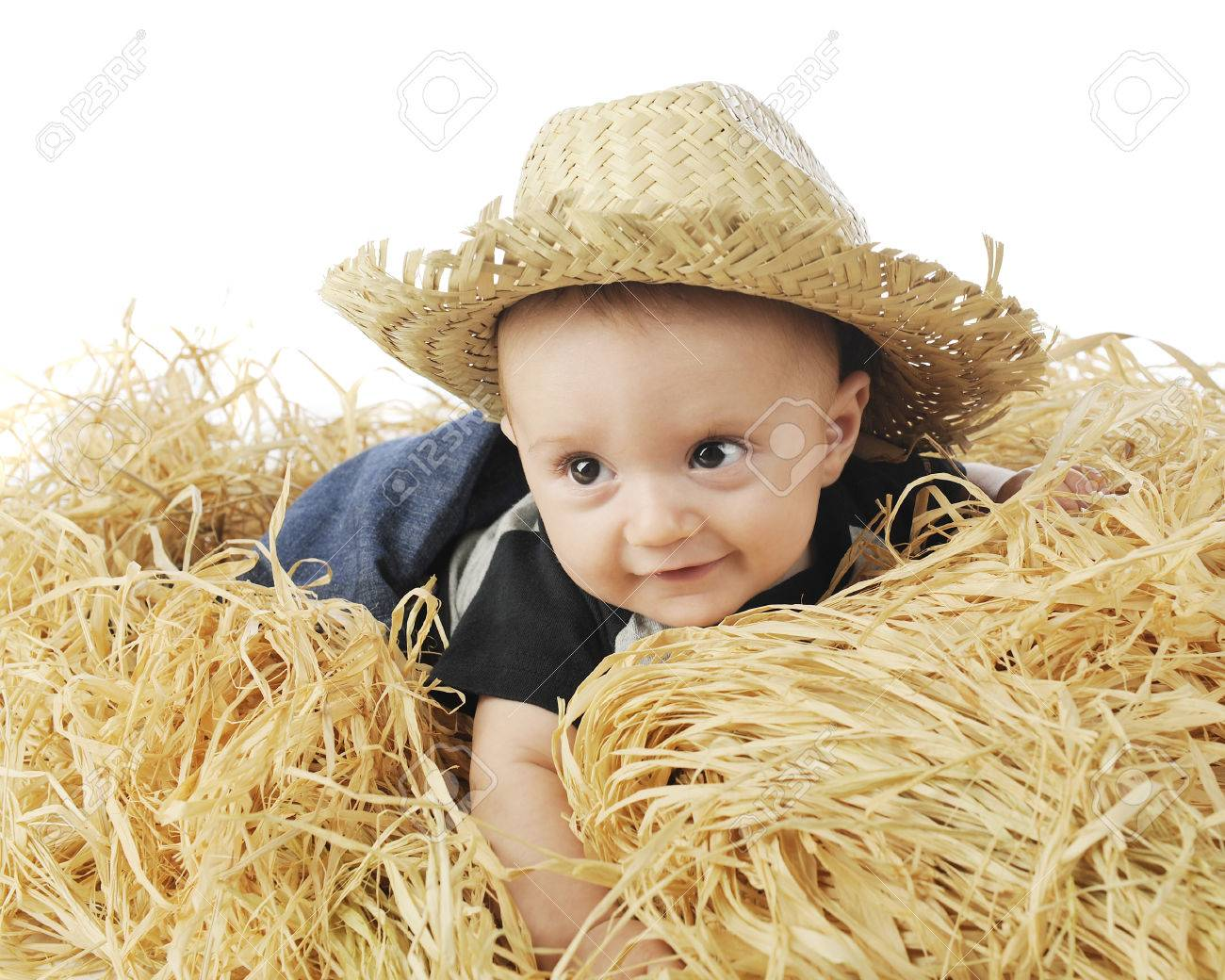 An adorable 3-month old baby farmer happily belly-down in the hay and 8132018aebd