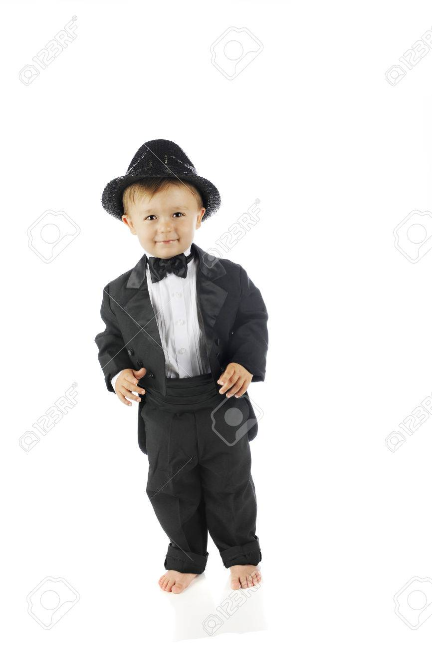 204fe361be673 An adorable barefoot toddler all decked out in a black tuxedo and sparkly  fedora. On