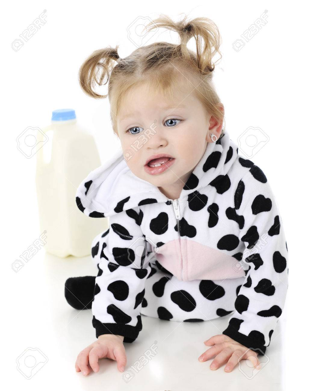 An adorable baby girl in a cow costume unhappily crawling away in from a half  sc 1 st  123RF.com & An Adorable Baby Girl In A Cow Costume Unhappily Crawling Away ...