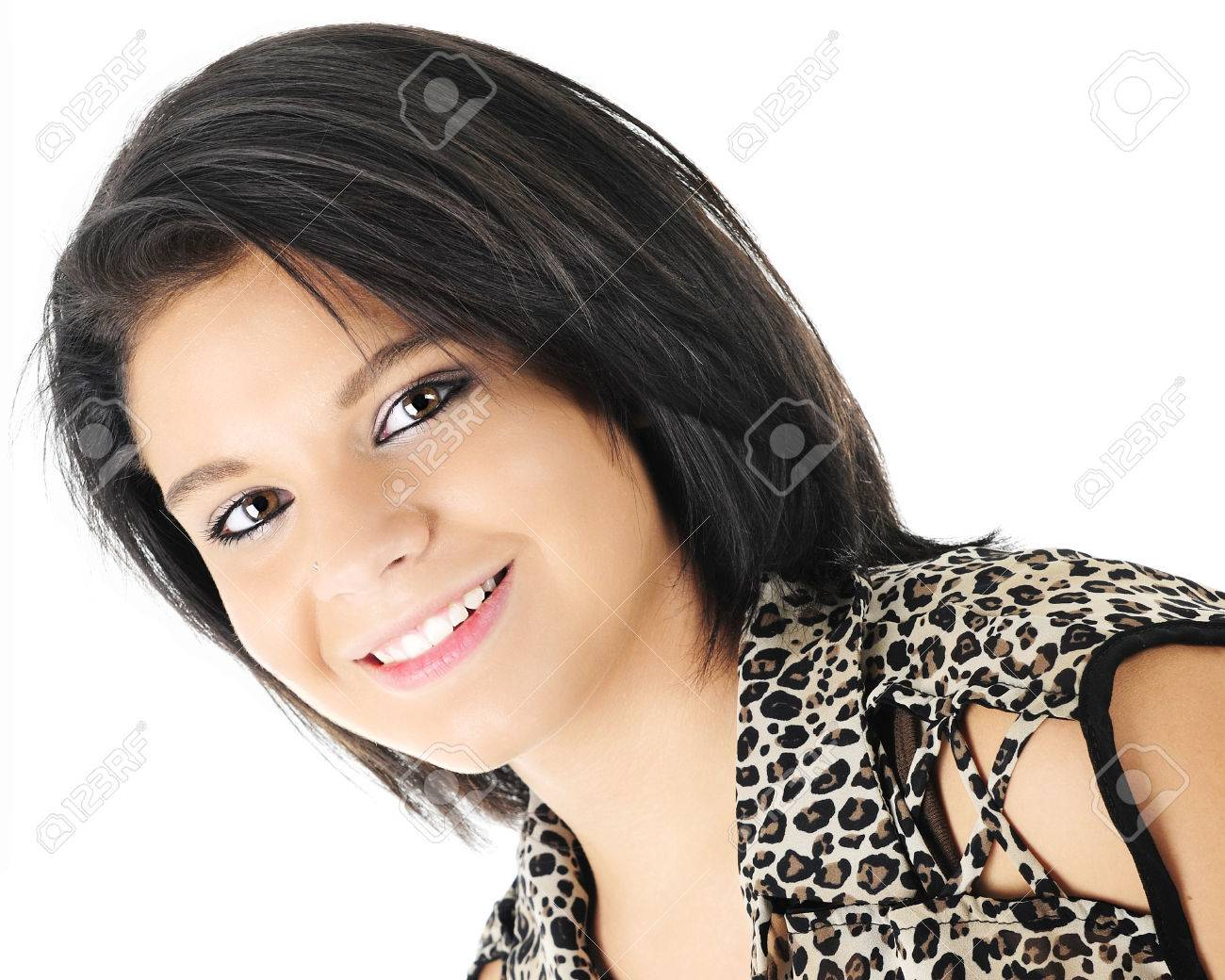 Head and shoulders image of a beautiful, dark-haired teen girl,..