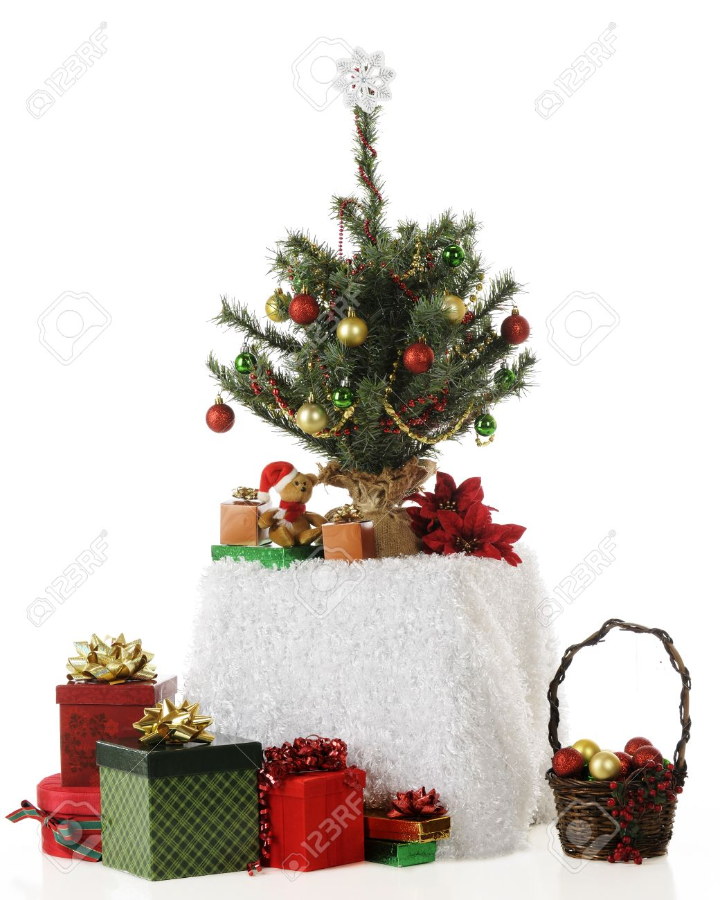 Tiny Christmas.A Tiny Christmas Tree On A Fluffy White Covered Table Surrounded