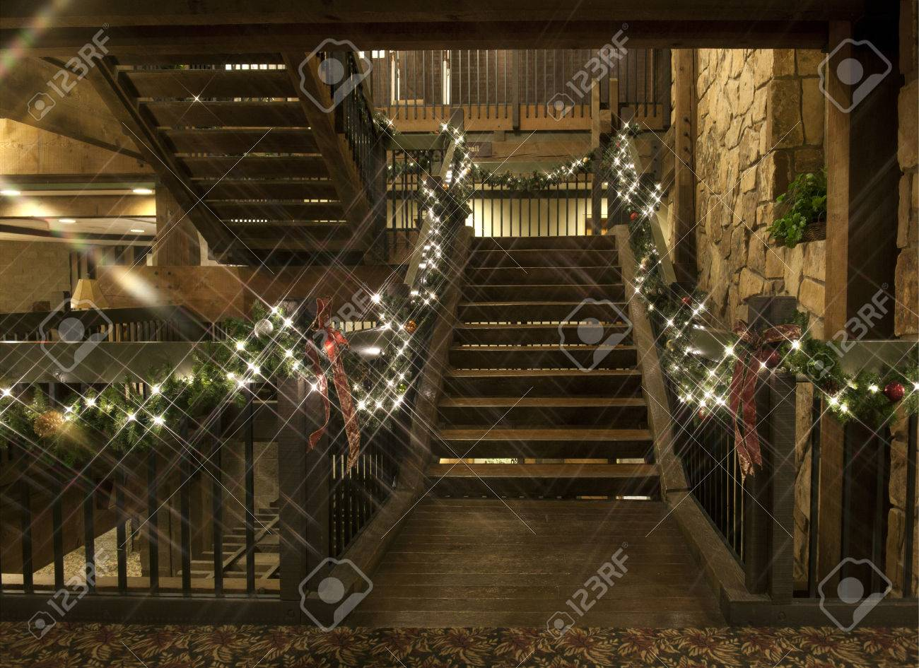 A Rustic Wooden Staircase Decorated With Christmas Garland Lights