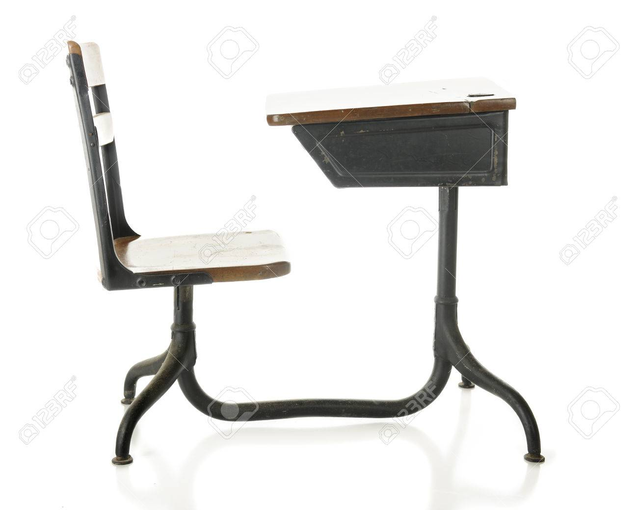 Side view of a child's antique school desk. On a white background. Stock  Photo - Side View Of A Child's Antique School Desk. On A White Background