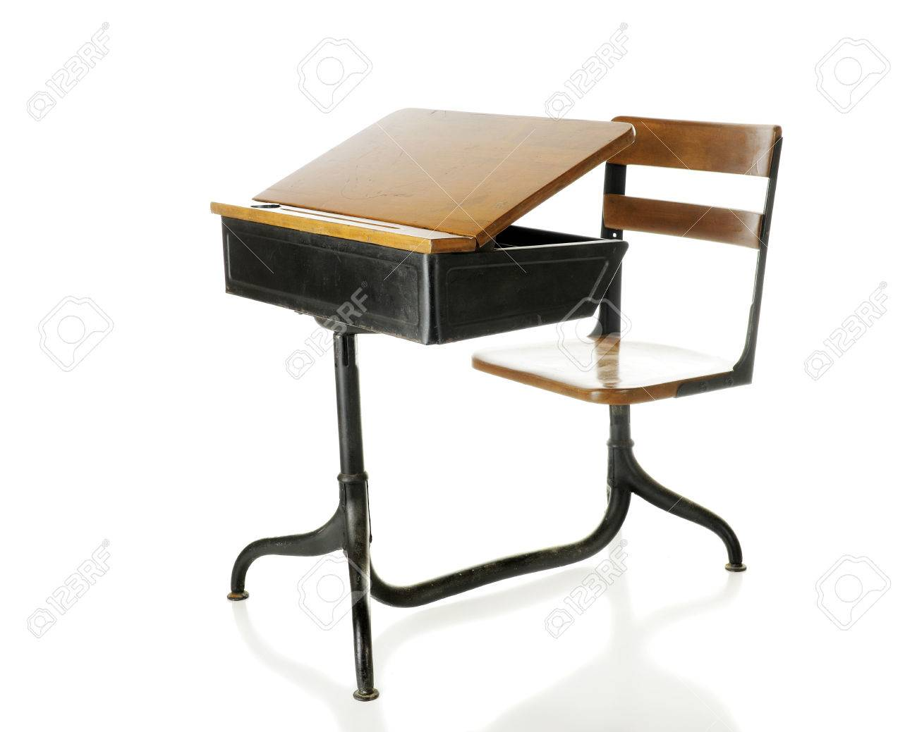 An antique school desk with an opened flip-top. Isolated on white. Stock - An Antique School Desk With An Opened Flip-top. Isolated On.. Stock