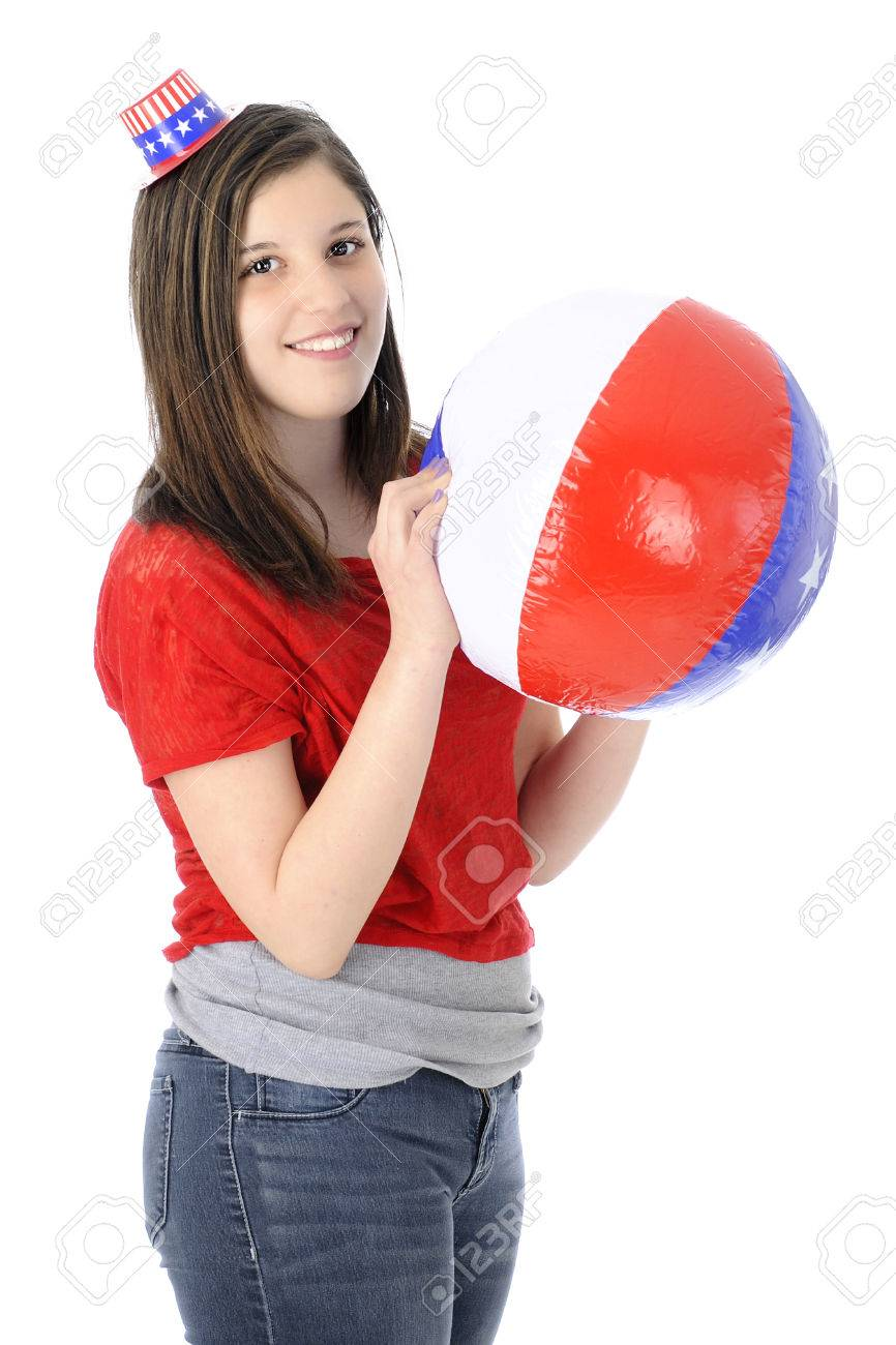 A beautiful young teen happily wearing a tiny Uncle Sam hat while holding  an inflated red