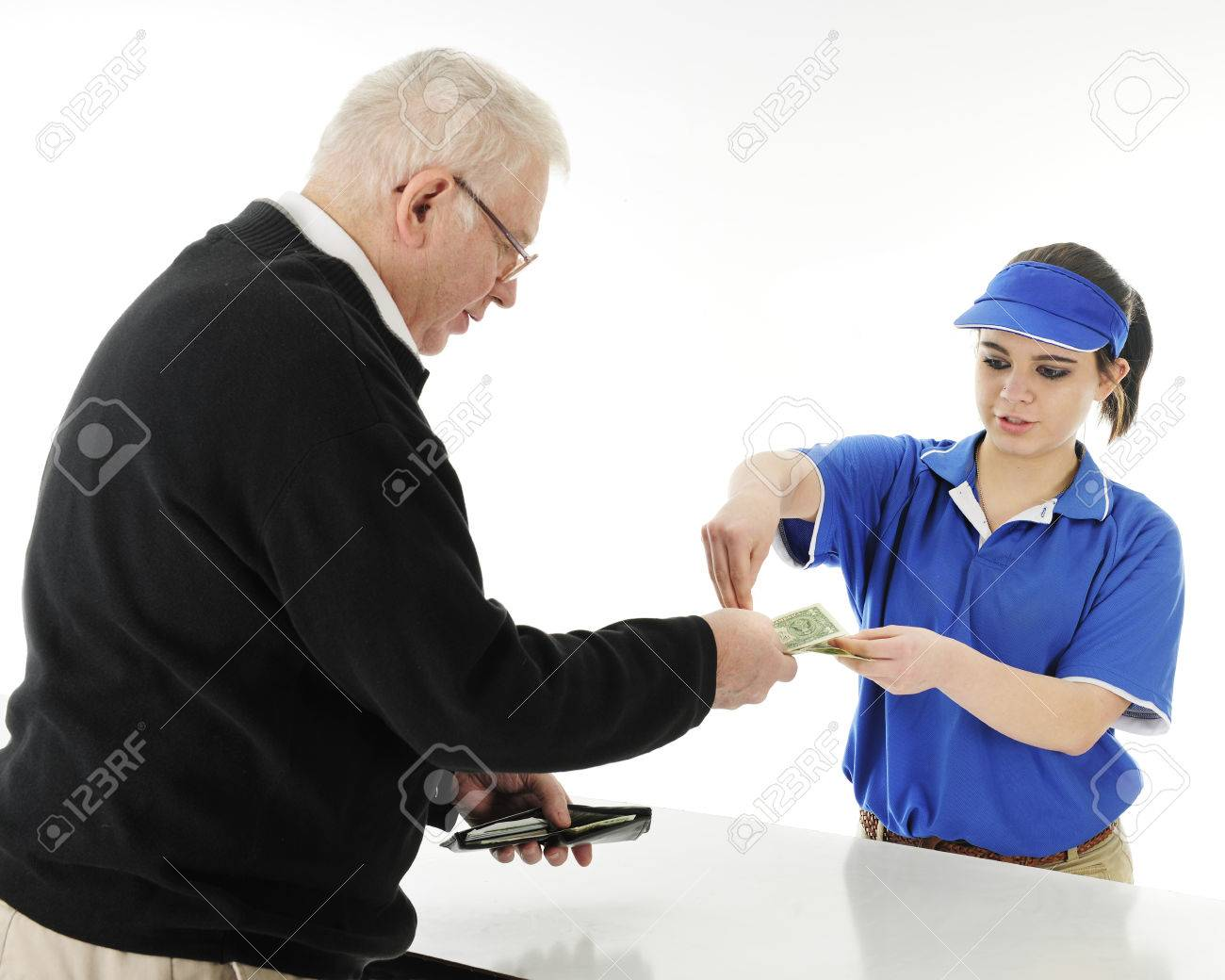 a teen fast food server returning change to a senior man customer a teen fast food server returning change to a senior man customer on a
