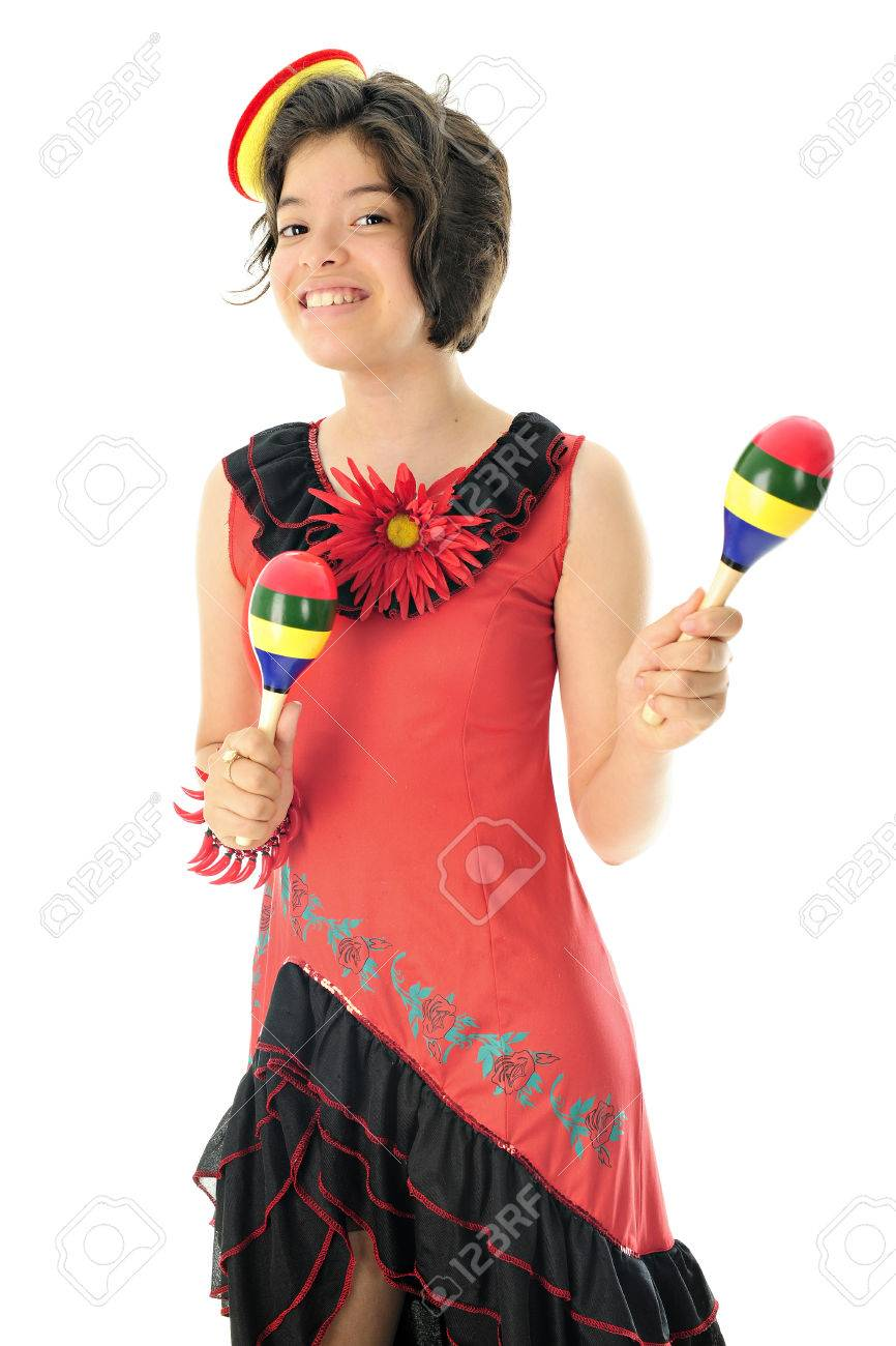 An attractive young teen happily wearing a red and black Mexican dress, a  tiny sombrero
