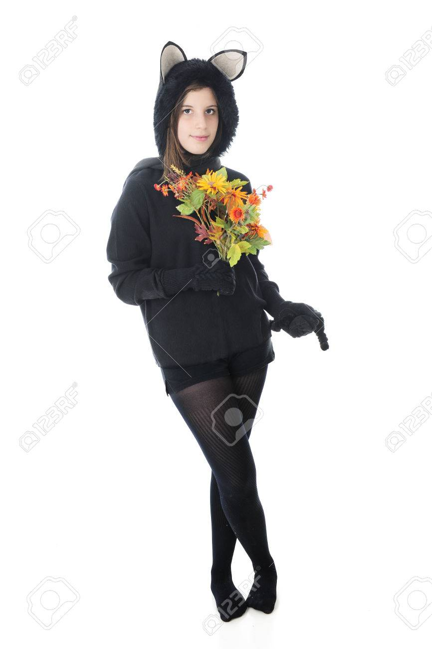 A Beautiful Teen Girl In A Black Cat Outfit, Holding A Bouquet ...