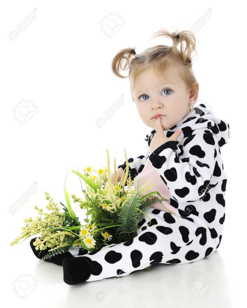 An adorable baby girl with a lap full of wild flowers thinking in her cow  sc 1 st  123RF.com & An Adorable Baby Girl With A Lap Full Of Wild Flowers Thinking ...