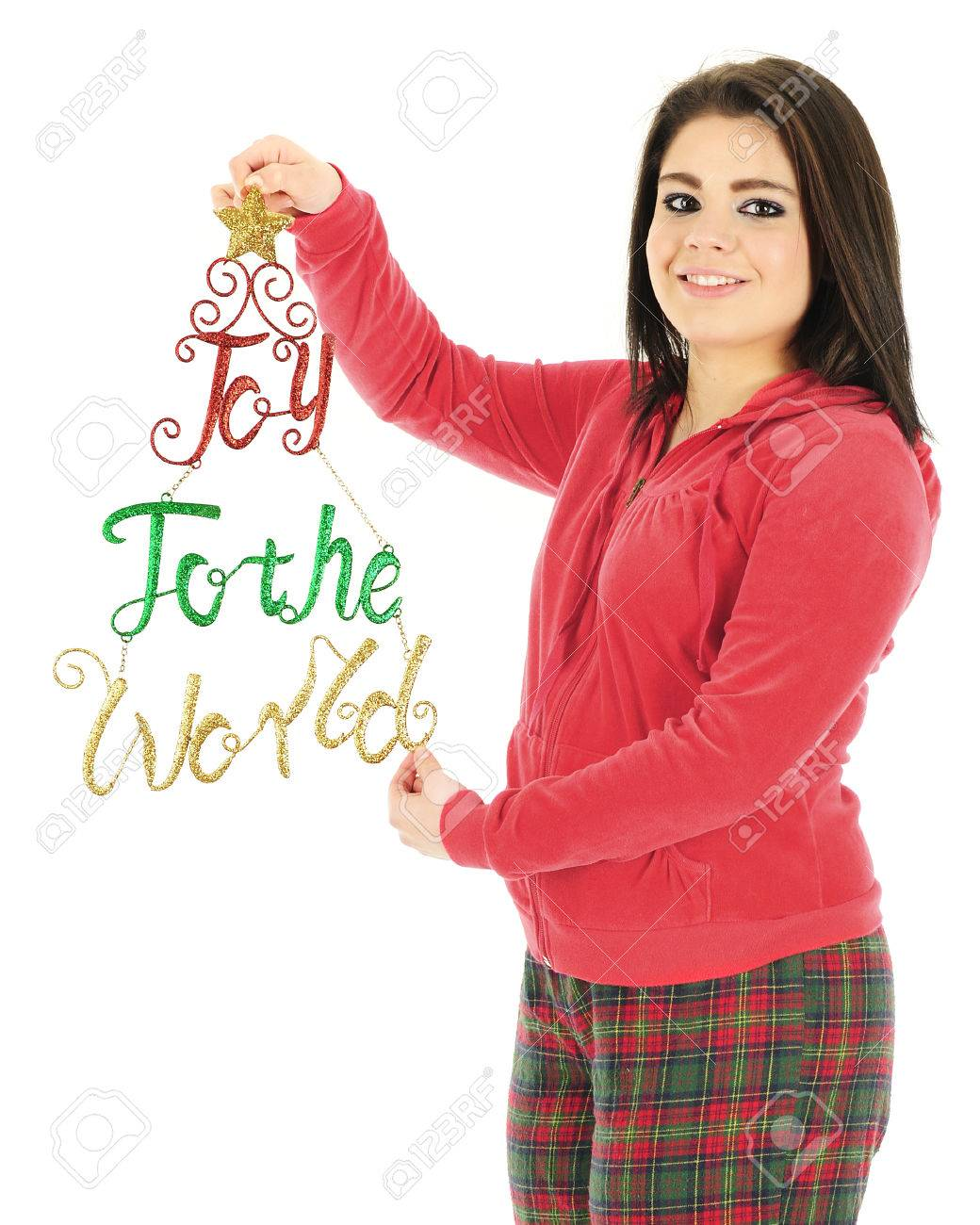 6f63080dc A Beautiful Teen Girl In Her Christmas Pajamas Holding A Sparkly ...