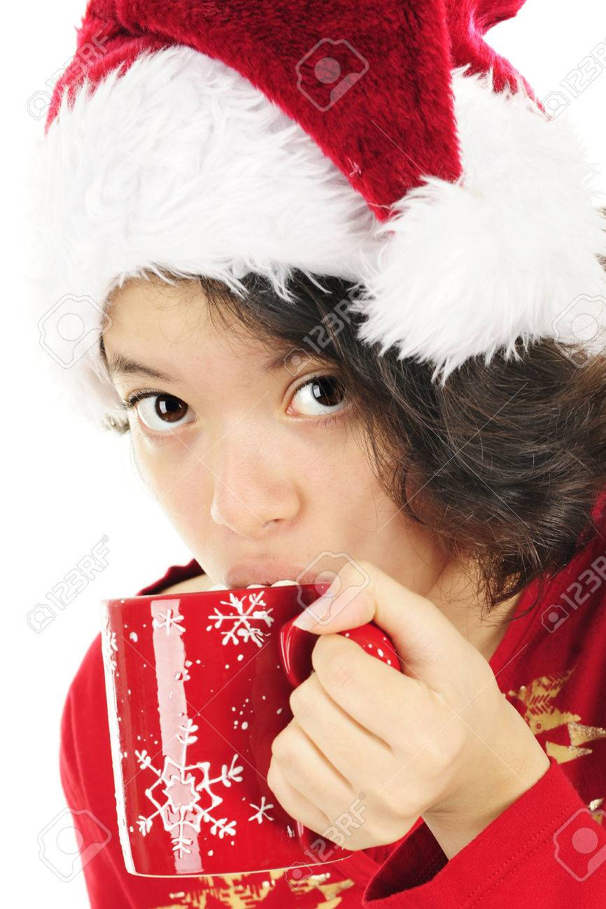 dfce18b45 Close-up Image Of A Young Teen Girl Sipping Cocoa With Marshmallows ...