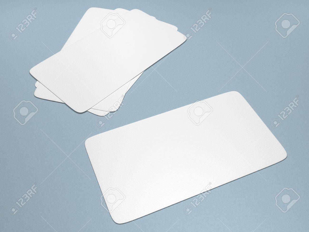 A set of blank business cards against a light blue background Stock Photo - 5140064