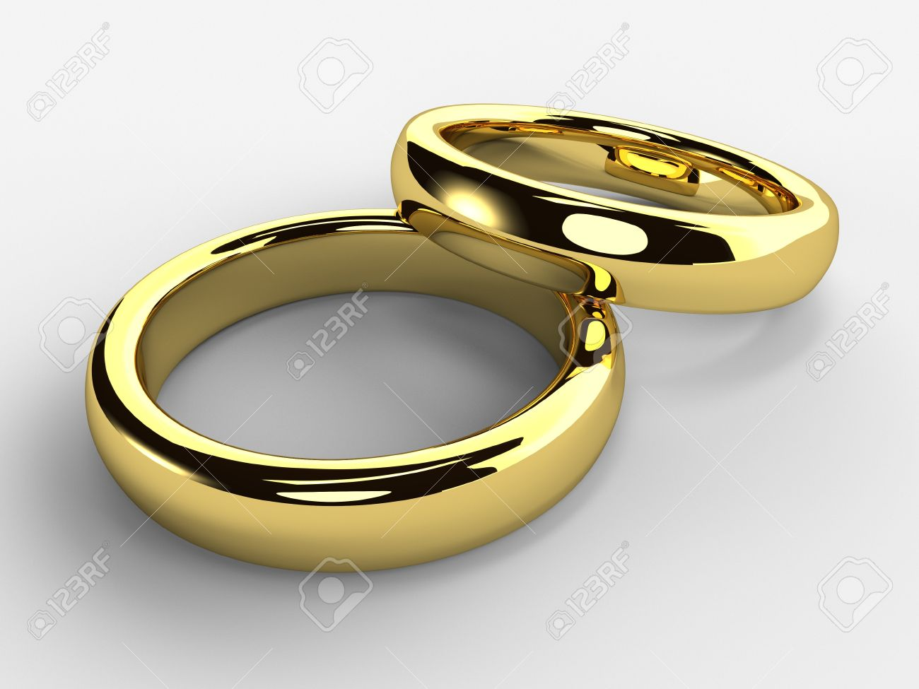 A Render Of Isolated Golden Wedding Rings One Each Other Stock Photo