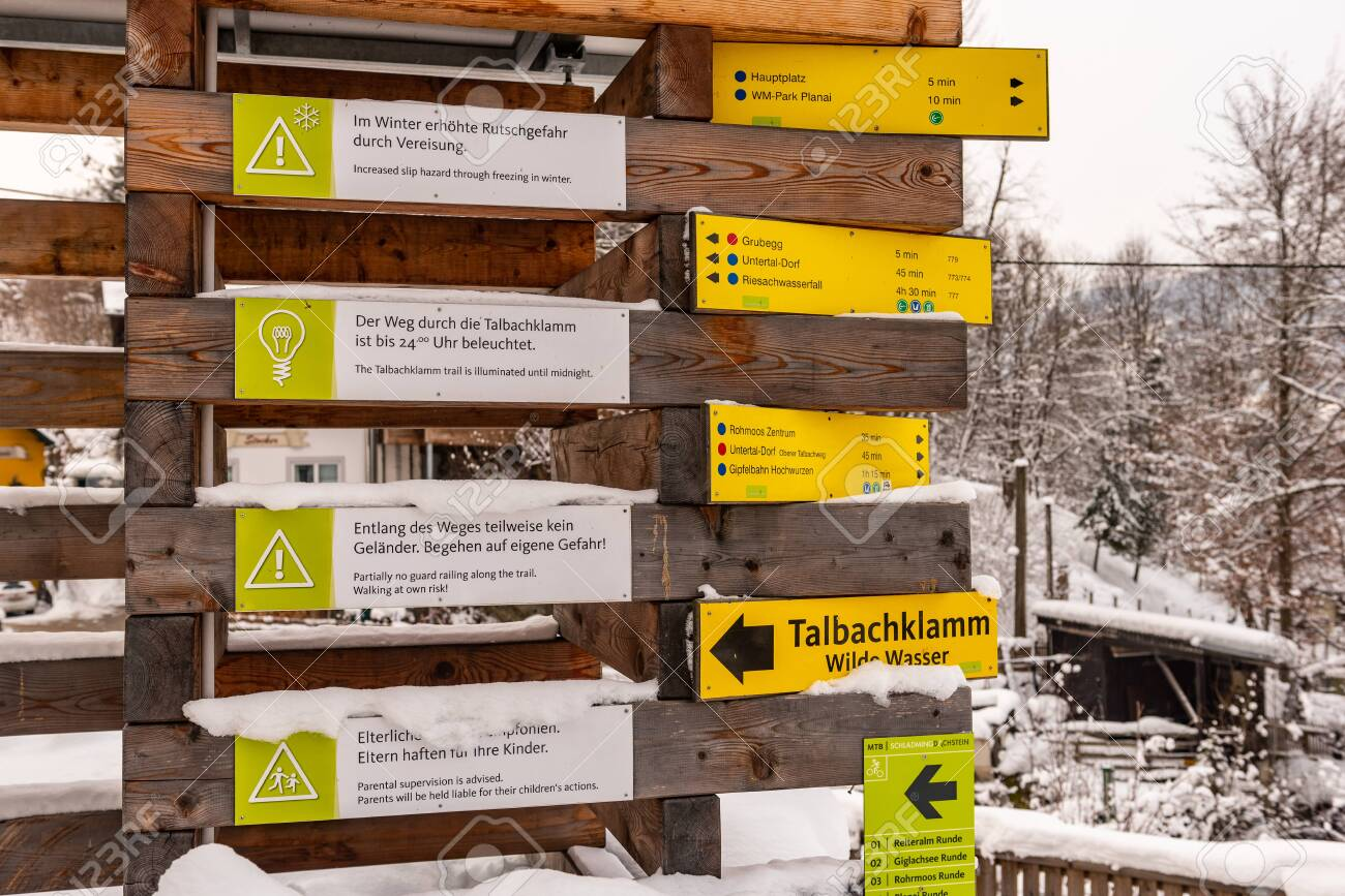 Yellow Tourist Directional Signs. Information to visitors about paths, attractions, distances and points of interest. Schladming Dachstein, Styria, Austria, Europe - 135052593