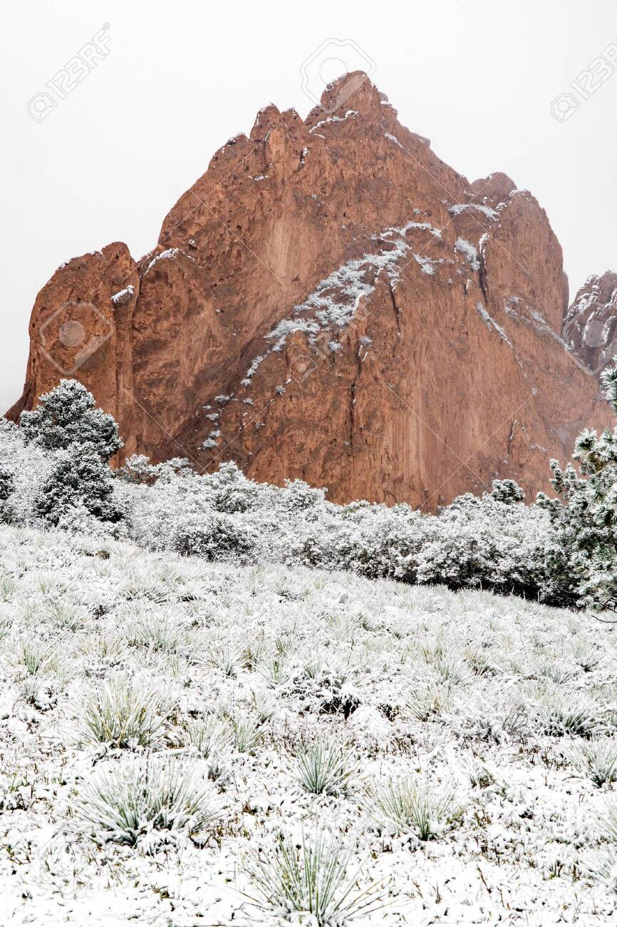 Snow Storm Can Be Seen Falling On The Garden Of The Gods In Colorado