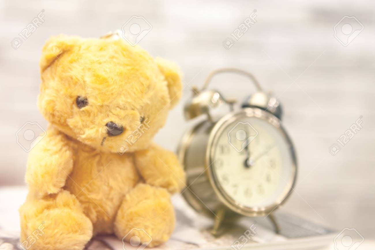 Retro Teddy Bear Toy Alone With Alam Clock In Lunch Time On Vintage ...