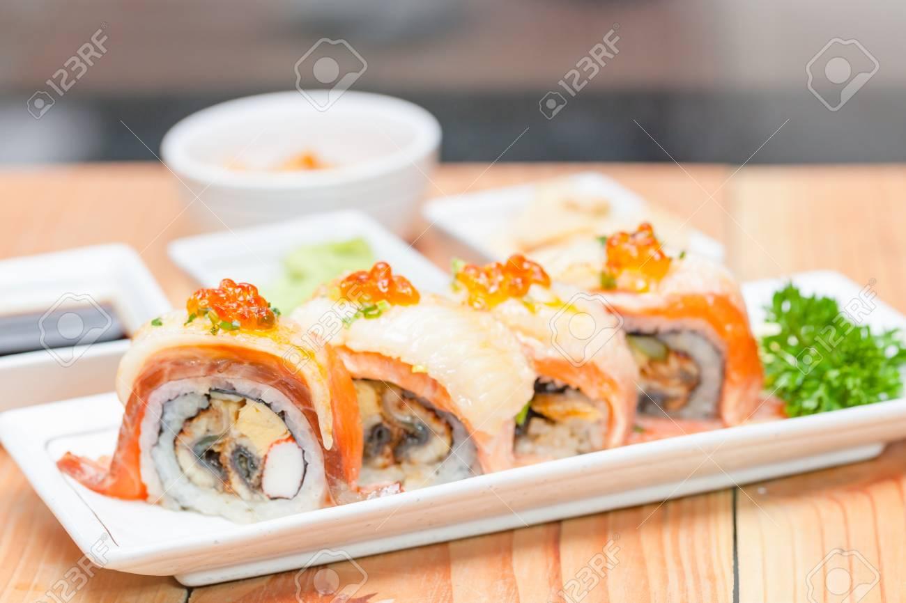 Closeup maki set at white plate on wooden table. japanese food concept. & Maki. Closeup Maki Set At White Plate On Wooden Table. Japanese ...