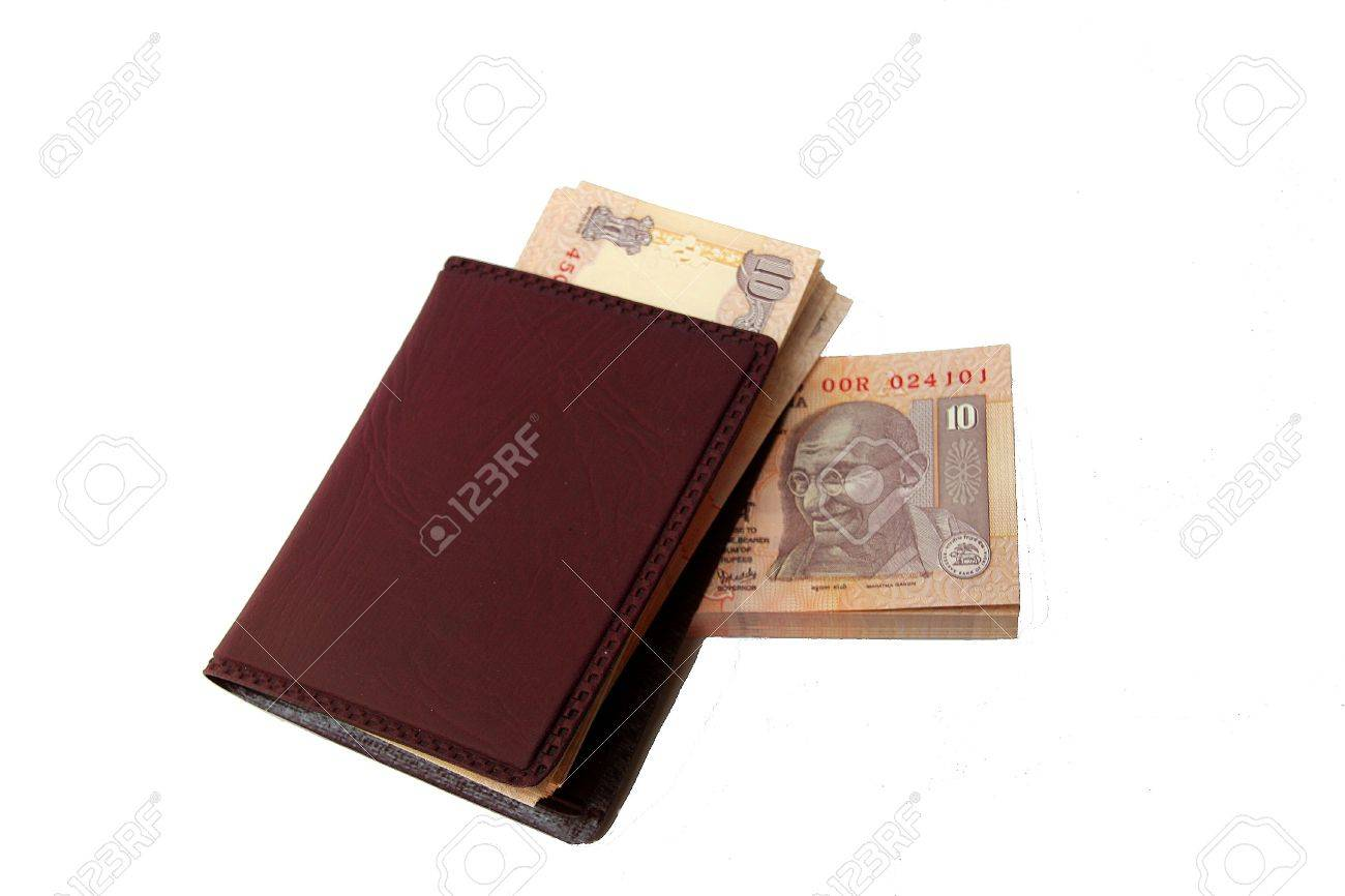 Indian currency notes and brown wallet separated on white background Stock Photo - 5528830