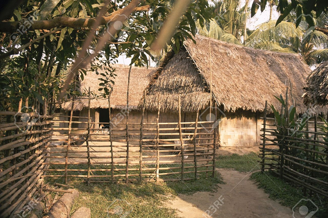 Huts And The Surrounding Bamboo Fence In A Typical Indian Village Stock Photo