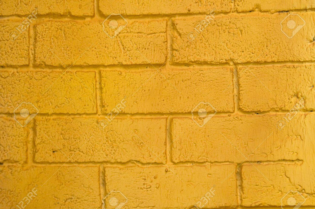 Laid Up Brick Wall Freshly Painted In Yellow-orange Color Stock ...