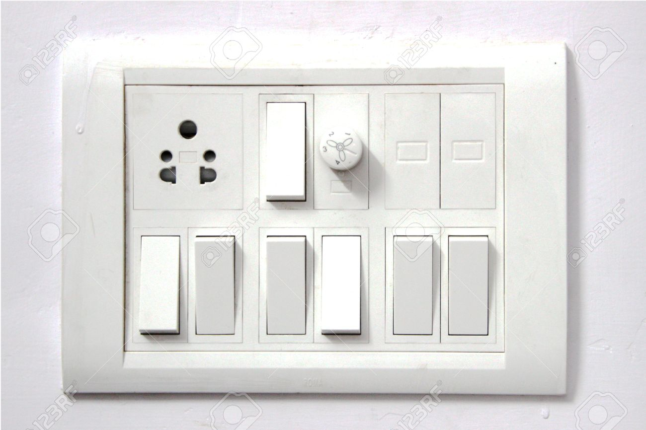 White Electrical Switch Board Panel On White Concrete Wall Stock ...