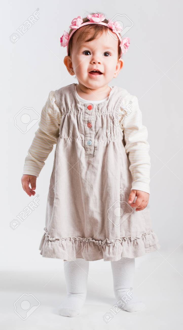Portrait of the small beautiful girl on a white background Stock Photo - 8606407