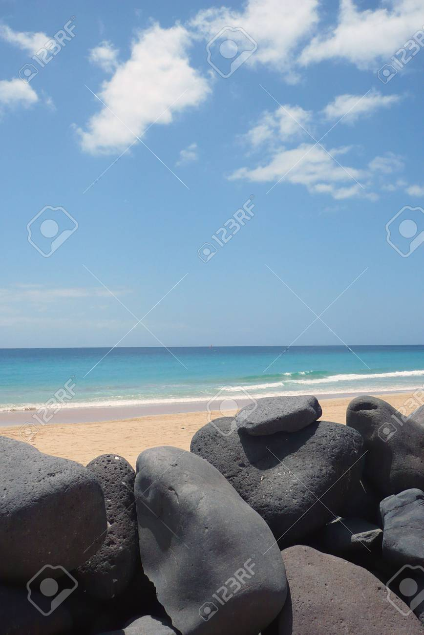 diurnal sight of some rocks on the beach near the ocean shore, with the ocean to the bottom Stock Photo - 5452637