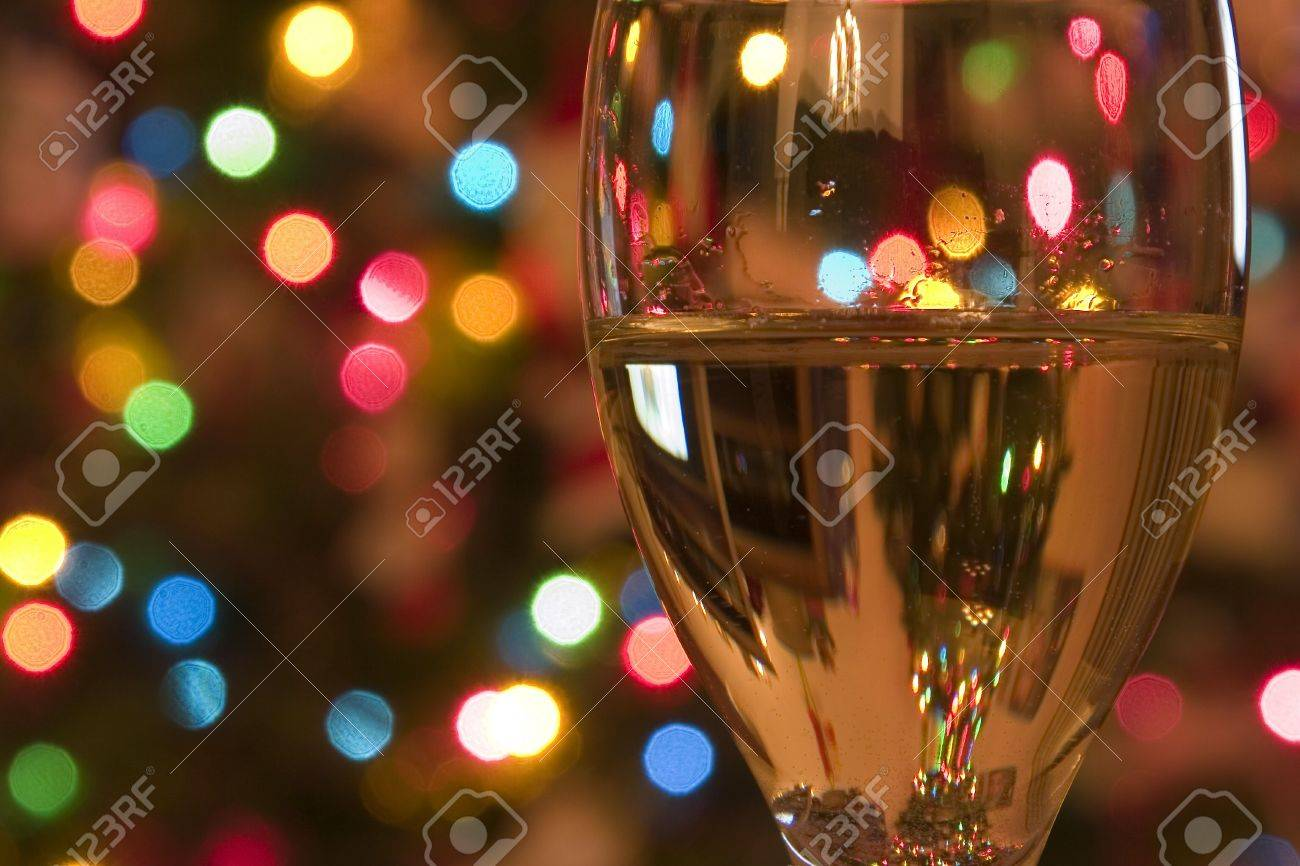 Close up on a Wine Glass with the Christmas lights on the background Stock Photo - 301741