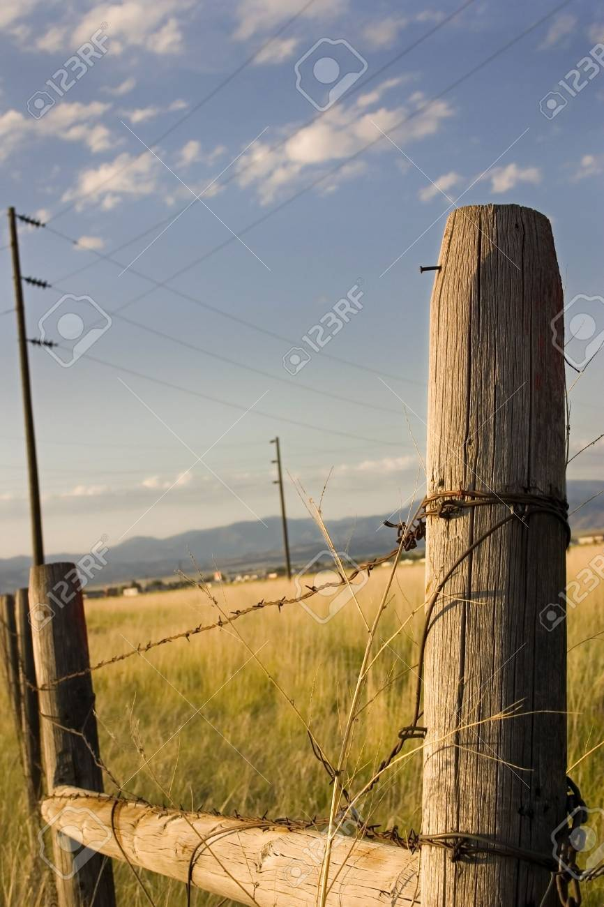 Wooden Fence with Electric Poles on the Background in Helena Montana Stock Photo - 631779