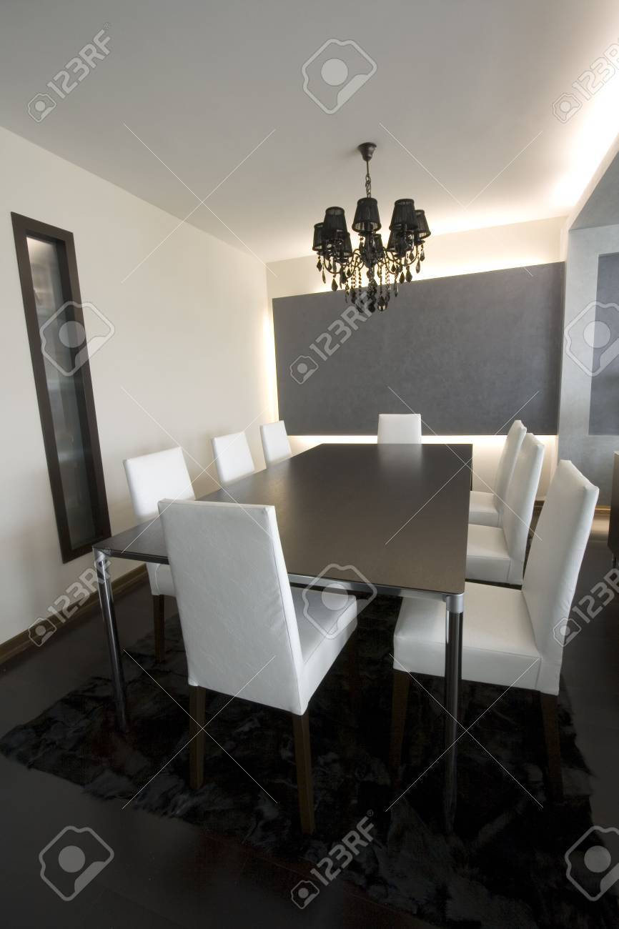 Trendy Modern Dining Room and Dinner Table Stock Photo - 2180474