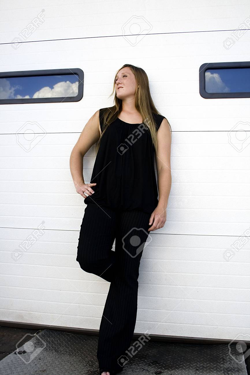 Sexy girl leaning against a door in the alley Stock Photo - 3550593