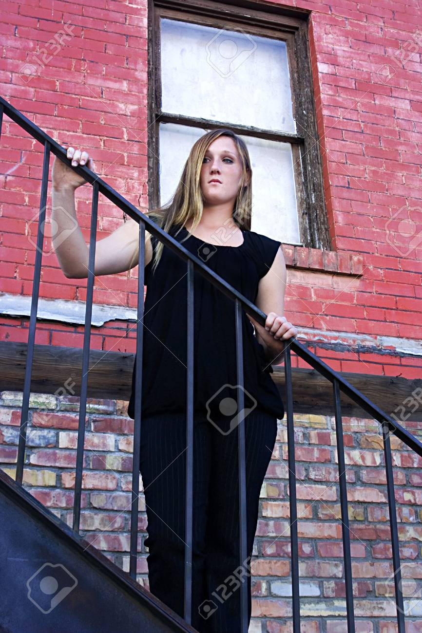 Beautiful Girl in Black dress posing outdoors in the City - Urban Stock Photo - 3602437