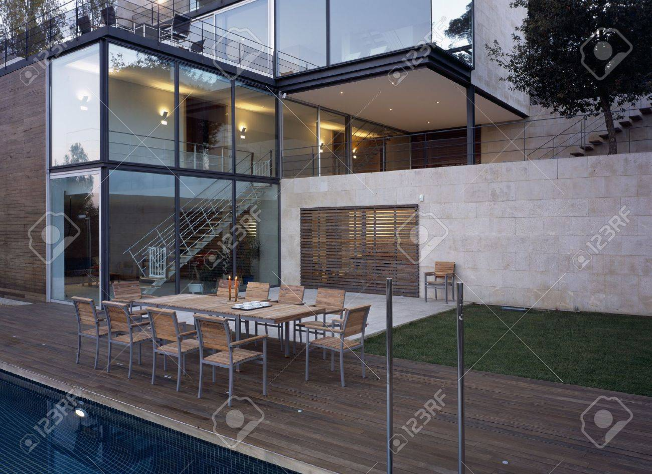 View of a dining area beside a pool Stock Photo - 7223882