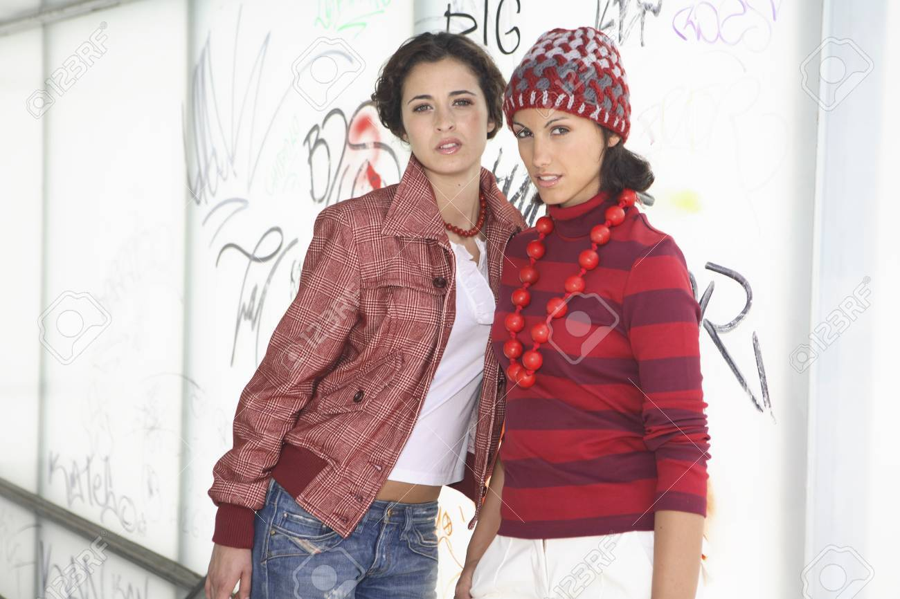 Two young women models dressed in red and white possing for a picture Stock Photo - 7475759