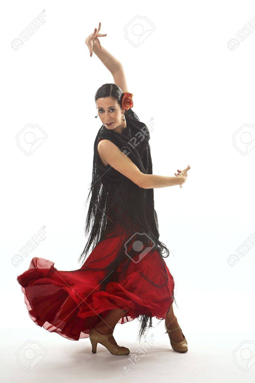 Typical spanish gypsy with carnation and fan, dancing Sevillanas. Stock Photo - 7475634