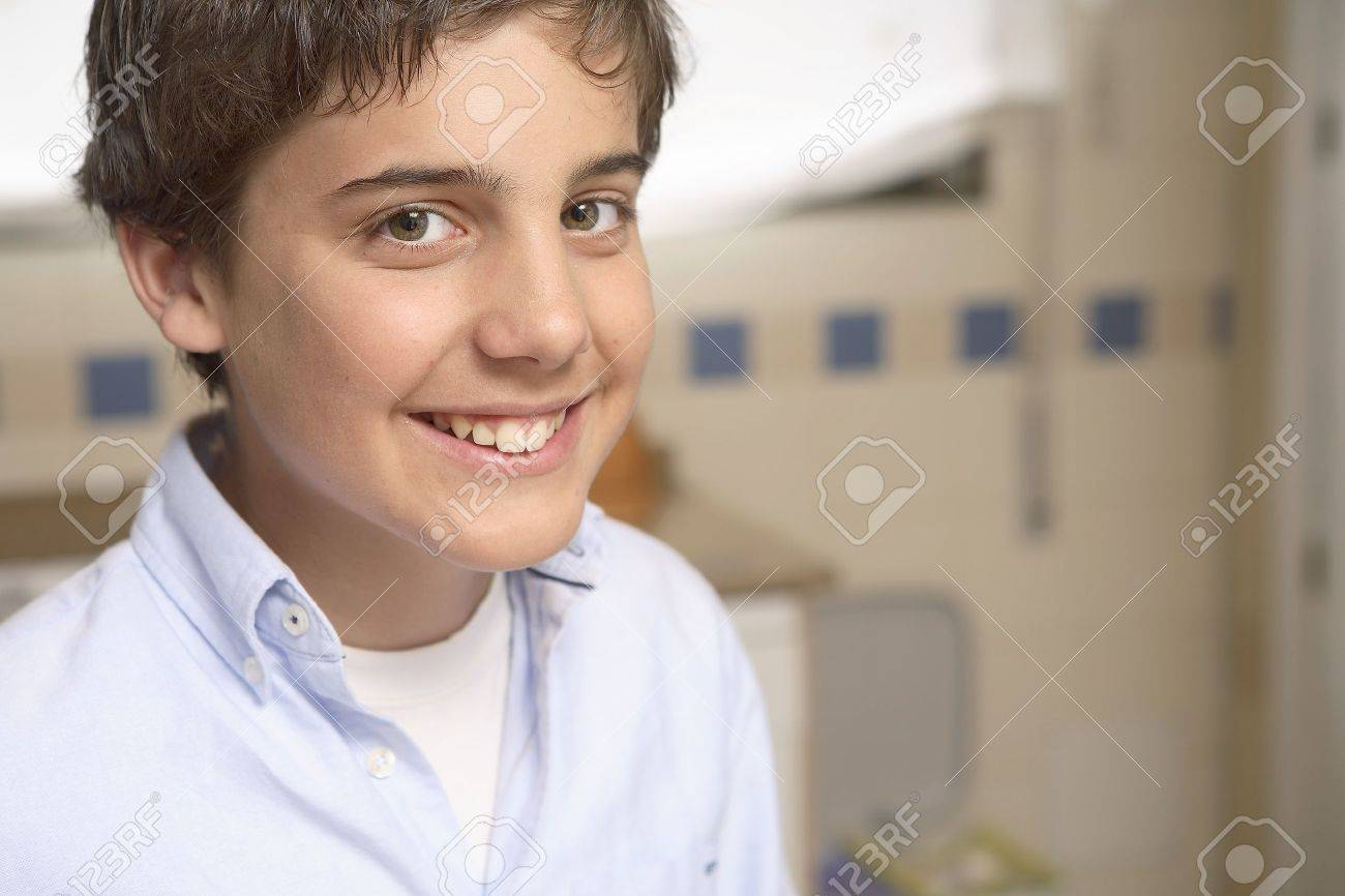 Portrait of 12 years old boy smiling looking at camera. Stock Photo - 7475763