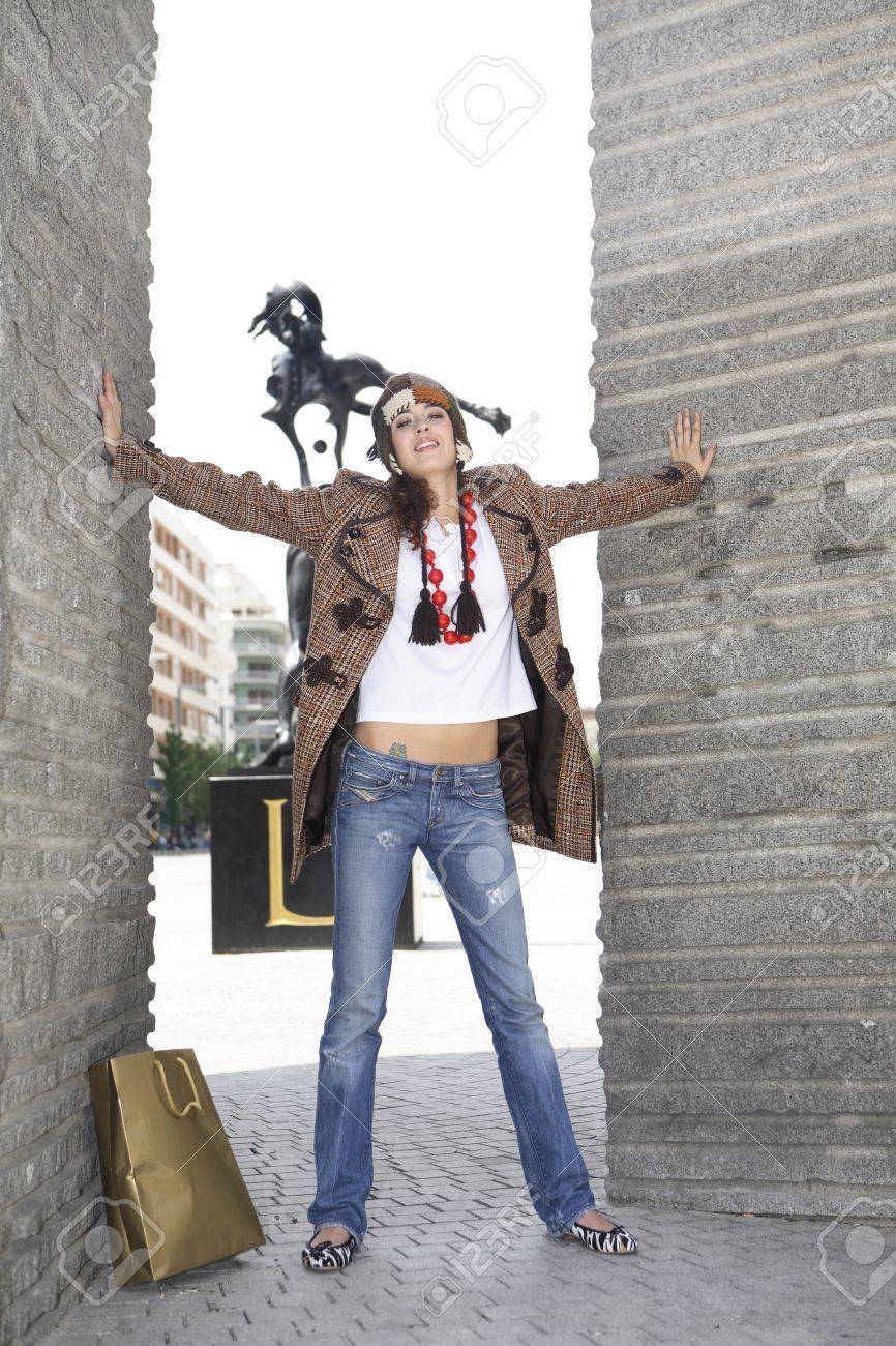 Young woman latin model possing with arms open in Avenue Felipe II, Madrid, Spain Stock Photo - 7483190